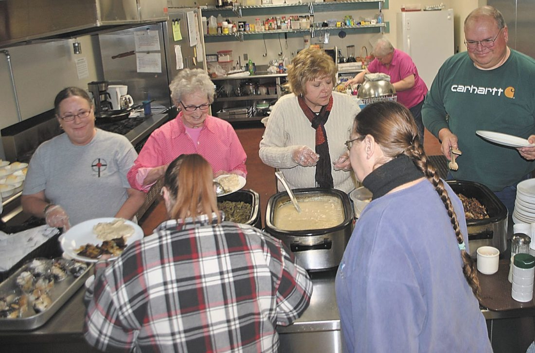 T-R FILE PHOTO The House of Compassion will host a Volunteer Appreciation Picnic on Friday, Sept. 22 from 5-8 p.m. at the Izaak Walton League, located at 2601 Smith Ave. in Marshalltown. Food and activities will be provided, and anyone who has volunteered at the HoC, such as these meal servers (pictured) and their families, are welcome to attend.