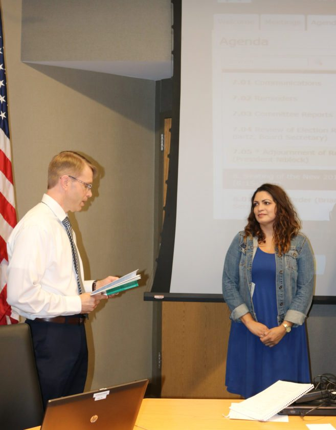 T-R PHOTO BY ADAM SODDERS The four winners of the 2017 Marshalltown School Board election were sworn in Monday evening as the new 2017-18 board was seated. Karina Hernández, right, will be the new face on the board as incumbents Bea Niblock, Mike Miller and Ben Fletcher retained their seats.