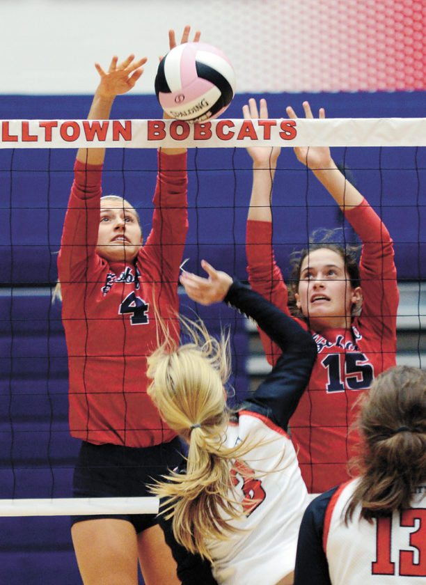 T-R PHOTO BY ROSS THEDE • Marshalltown's double block of Emily Hass (4) and Erica Johnson (15) turn back the attack by Mason City's Alicia Hoeft (3) during the second set of Tuesday's CIML Iowa Conference match at the Roundhouse. The Bobcats beat Mason City in three sets, 25-15, 25-14, 25-15.