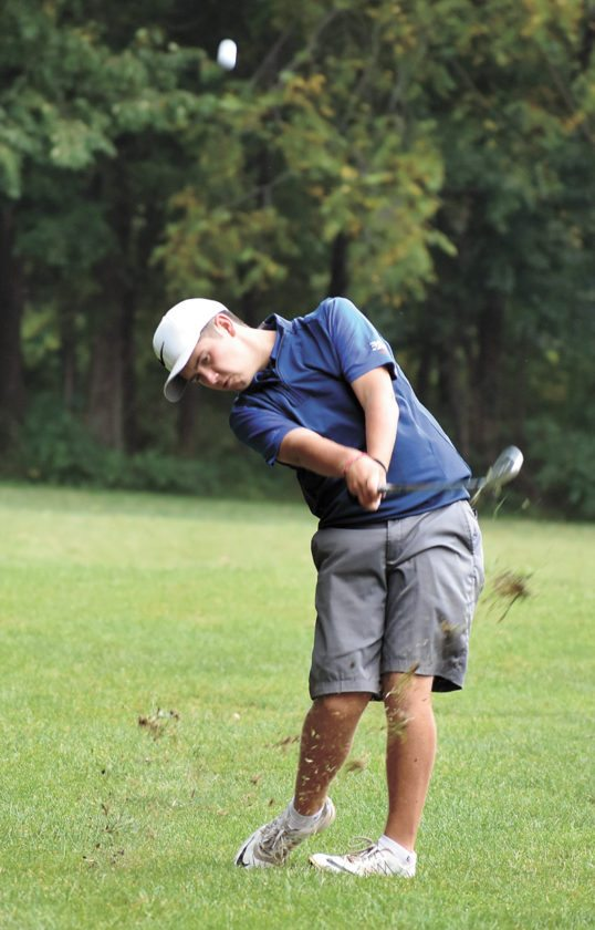 T-R PHOTO BY THORN COMPTON • Marshalltown junior JD Pollard strikes the ball on his approach shot on the 15th hole at Copper Creek Golf Club in Pleasant Hill on Wednesday. The Bobcats won the Southeast Polk Invite with a team score of 295.