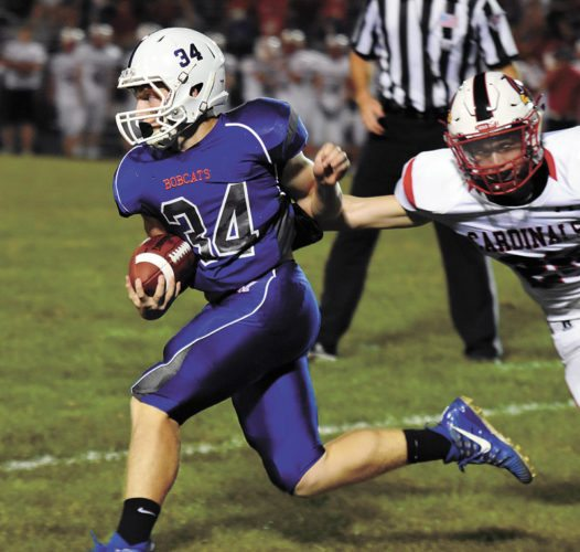 T-R PHOTO BY THORN COMPTON • Mashalltown junior Giorgio Diiorio (34) avoids Newton defender Aaron Bartels during a run in the first quarter of the Bobcats' Homecoming loss to the Cardinals.
