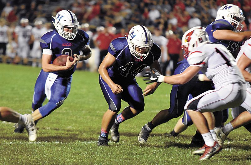 T-R PHOTO BY THORN COMPTON • Marshalltown quarterback Sam Irwin (2) prepares to plunge into the line on his way to scoring a rushing touchdown during the second quarter in the Bobcats' 49-28 loss to Newton on Friday.