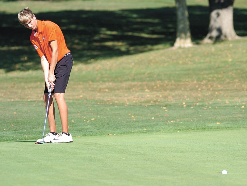 T-R PHOTO BY ROSS THEDE • Marshalltown sophomore Lucas Schneider sinks a birdie putt on the 10th green during the match play portion of Friday's Bobcat-Dragon Ryder Cup at Elmwood Country Club. Schneider defeated Johnston's Joe Paul in their singles match, 6 1/2 to 3 1/2.
