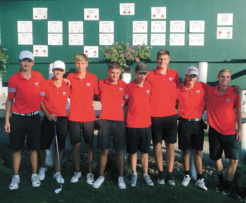 T-R PHOTO BY ROSS THEDE • The Marshalltown boys' golf team poses for a photo in front of the scoreboard after defeating Johnston 94-66 in the Bobcat-Dragon Ryder Cup on Friday at Elmwood Country Club. Pictured, from left, are Cole Davis, Nate Vance, Lucas Schneider, Tate Carlson, Mason Reid, Luke Appel, Keygan Hansen and Conner Beaty.
