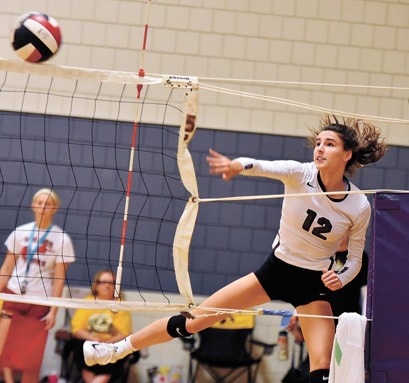 T-R PHOTO BY THORN COMPTON • Grundy Center junior Hailey Wallis (12) sends a shot across the net during the Spartans' win over Fort Dodge in pool play on Saturday in the Tiger Volleyball Invitational. Grundy Center would sweep its pool but lose in the first round of the championship bracket to Center Point-Urbana.
