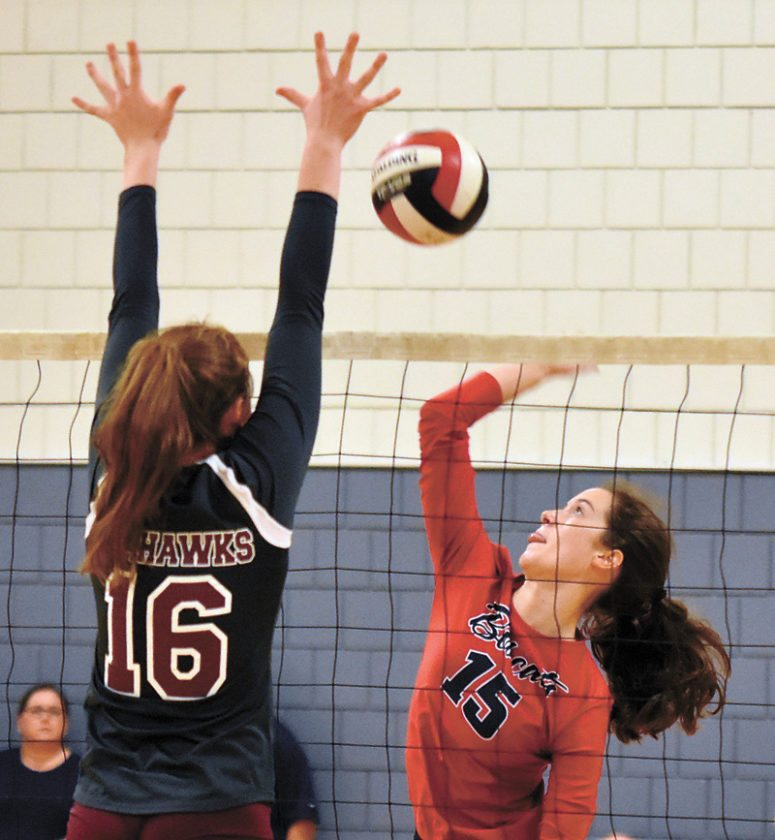 T-R PHOTO BY THORN COMPTON • Marshalltown sophomore Erica Johnson (15) goes up against Waterloo West's Kaylissa Arndorfer (16) during the Bobcats' two-set sweep of the Wahawks in the consolation bracket of the Tiger Volleyball Invitational in Cedar Falls on Saturday.