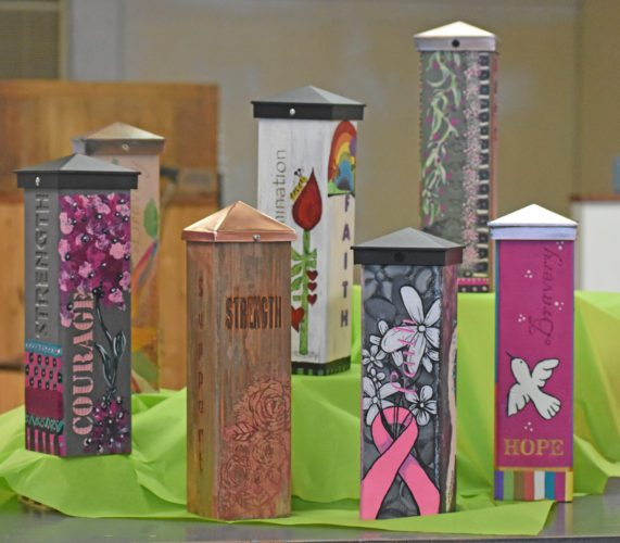 "T-R PHOTO BY MIKE DONAHEY  Shown are ""Pillars of Strength,"" decorated wood blocks  each hand-crafted by volunteers, which will be part of a silent auction at the 6th Annual Breast Cancer Awareness Luncheon, Oct. 5 at Elmwood Country Club. Sponsored by UnityPoint Health-Marshalltown Foundation, all proceeds fund free mammograms for under-insured or non-insured women."