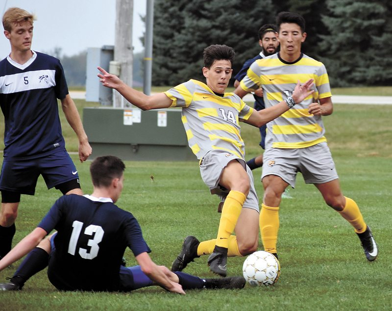 T-R PHOTO BY THORN COMPTON • Marshalltown Community College player Bruno Osorio (14) fights for possession during the first half of the Tigers' 8-1 victory over the Mount Mercy junior varsity on Monday.