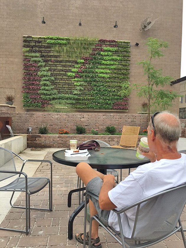 CONTRIBUTED PHOTO  Steve Bolar of Marshalltown is shown enjoying a cup of coffee in the local Gallery Garden in the 100 block of East Main Street. The Gallery Garden is a privately owned, one-of-a-kind urban-style green space open to the public. It was developed to address storm water runoff. Additionally, it features artwork and a sculpture.