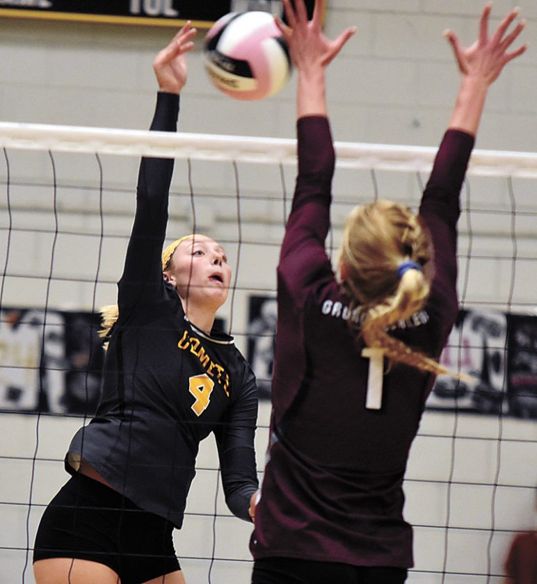 T-PHOTO BY THORN COMPTON • BCLUW senior Lauren Anderson (4) hits the ball across the net while Grundy Center senior Landry Luhring (1) goes for the block during the Comets' senior night loss to the Spartans on Tuesday.