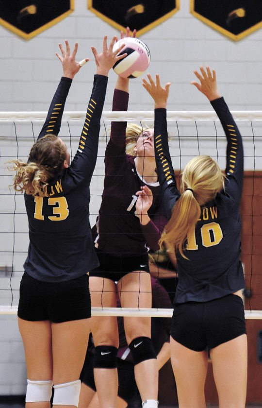 T-R PHOTO BY THORN COMPTON • Grundy Center sophomore Emerson Kracht, center, sends a shot across the net while BCLUW's Easton Swanson (13) and Madison Ubben (10) attempt to block it during the Spartan's three-set sweep of the Comets in Conrad on Tuesday.
