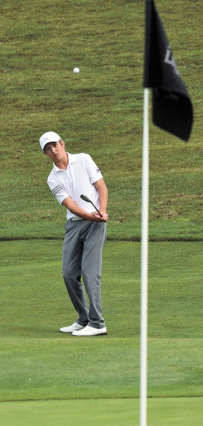 T-R PHOTO BY THORN COMPTON • Marshalltown sophomore Cole Davis hits a chip onto the 11th green at The Legacy Golf Club in Norwalk on Wednesday during the second hole of a playoff for the CIML Conference Tournament champion. Davis would finish second to Johnston's Nick Pittman.