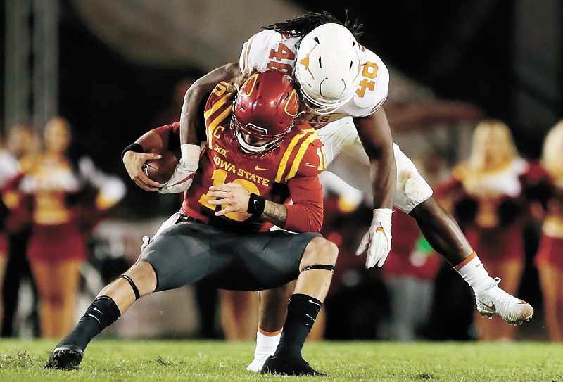 AP PHOTO • Iowa State quarterback Jacob Park is sacked by Texas linebacker Malik Jefferson (46) during the second half of a Big 12 Conference football game Thursday night at Jack Trice Stadium in Ames. Texas won 17-7.