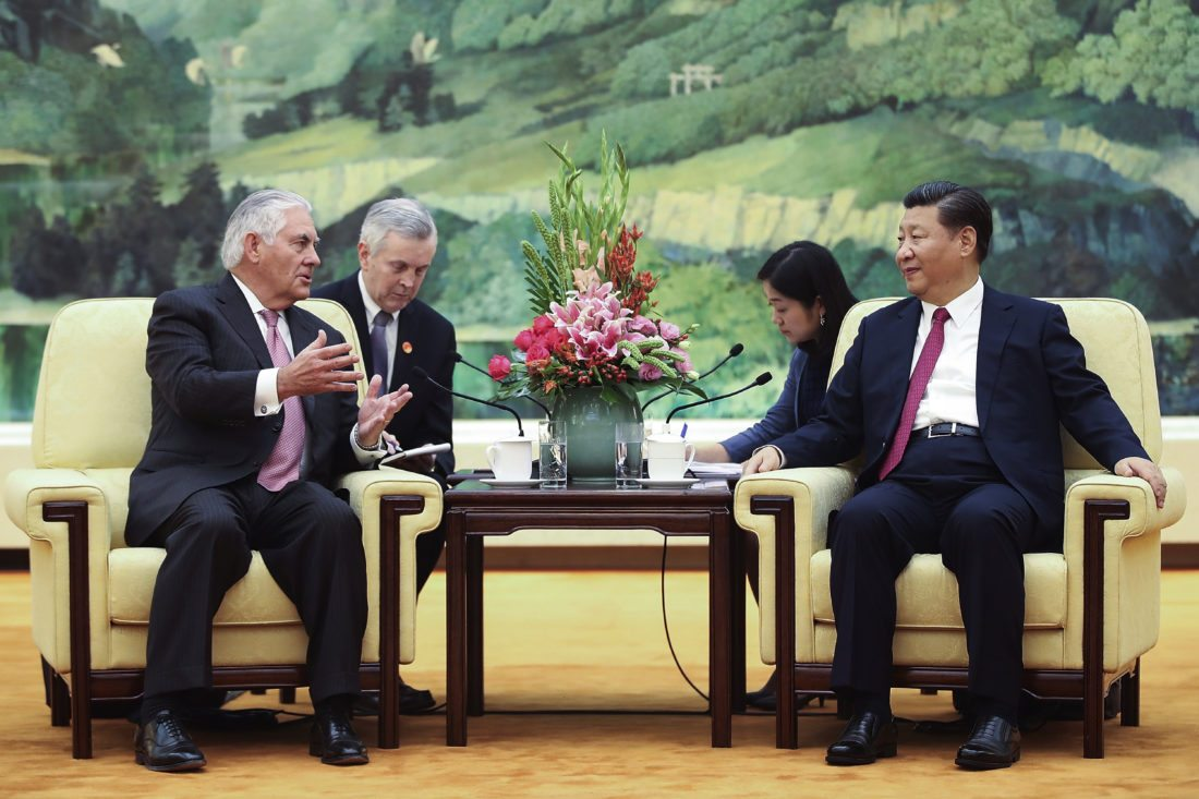 U.S. Secretary of State Rex Tillerson, left, meets with China's President Xi Jinping at the Great Hall of the People, Saturday, Sept. 30, 2017, in Beijing. (Lintao Zhang/Pool Photo via AP)