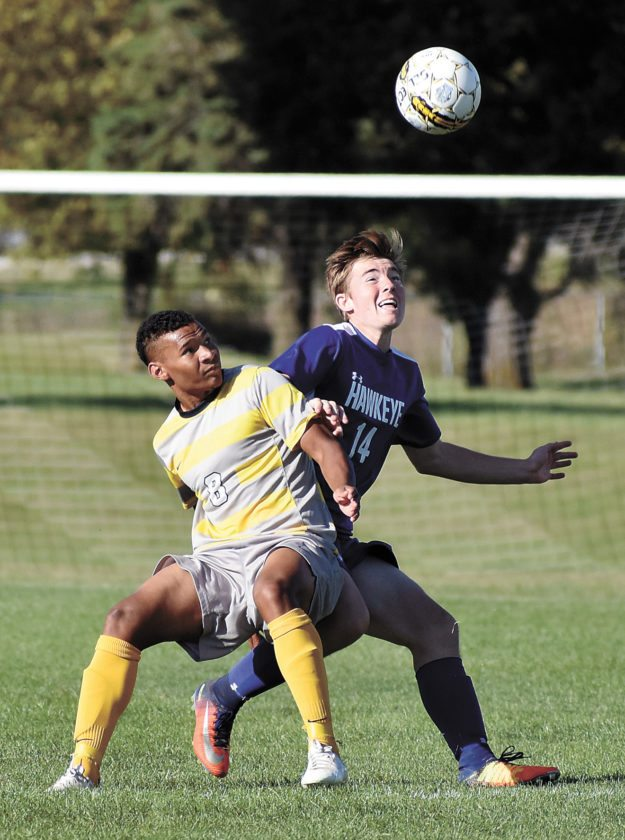 T-R PHOTO BY THORN COMPTON • Marshalltown Community College defender Breno Scomparim (8) and Hawkeye Community College's Jaden Fluge (14) jockey for position during the Tigers' win over the RedTails on Saturday.