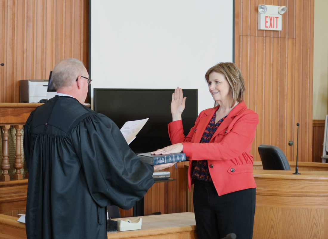 T-R PHOTO BY ADAM SODDERS New Marshall County Auditor-Recorder Nan Benson was sworn into office by District Court Judge John Haney Tuesday morning, following the Marshall County Board of Supervisors' approval of her appointment to replace Deanne Raymond at the position.