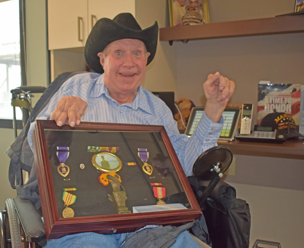 Dennis Julian, an Iowa Veterans Home resident, displays a number of medals earned while serving in the U.S. Marine Corps during service in Vietnam. His IVH room is adorned with Marine mementos