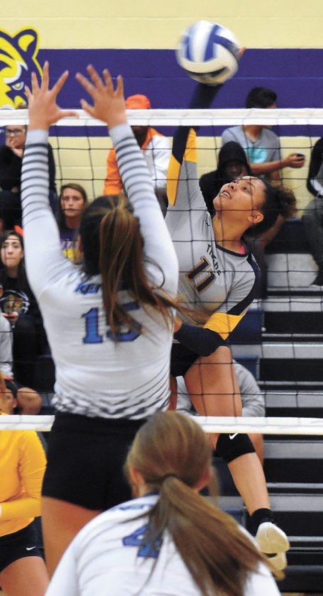 T-R PHOTO BY THORN COMPTON • Marshalltown Community College hitter Jesenia Colbert (11) delivers a strike while Iowa Western setter Hina Pua'a attempts a block during the Reivers' win over the Tigers at MCC on Wednesday.
