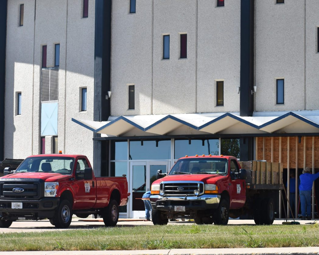 T-R FILE PHOTO By MIKE DONAHEY  Trucks and staff from Marshalltown Community School District's Buildings and Grounds Department are shown earlier this year on the north side of the Marshalltown High School Roundhouse. Staff were dispatched to the scene to make immediate repairs after two suspects crashed a stolen truck into the doors of the roundhouse. Marshalltown police arrested two juveniles Thursday in connection to the incident.