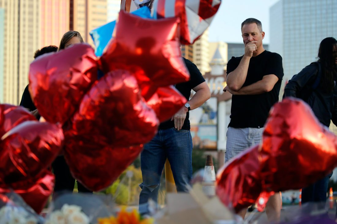 AP PHOTO Greg Arnerich, of Mesa, Ariz., pauses at a memorial for the victims of a mass shooting in Las Vegas earlier this week.
