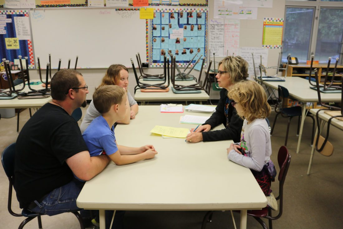Parent-teacher conferences offer families and school staff a chance to discuss students' education and progress. One such face-to-face meeting was this one in Lenihan Intermediate School fifth-grade teacher Julie Finch's classroom Thursday evening.