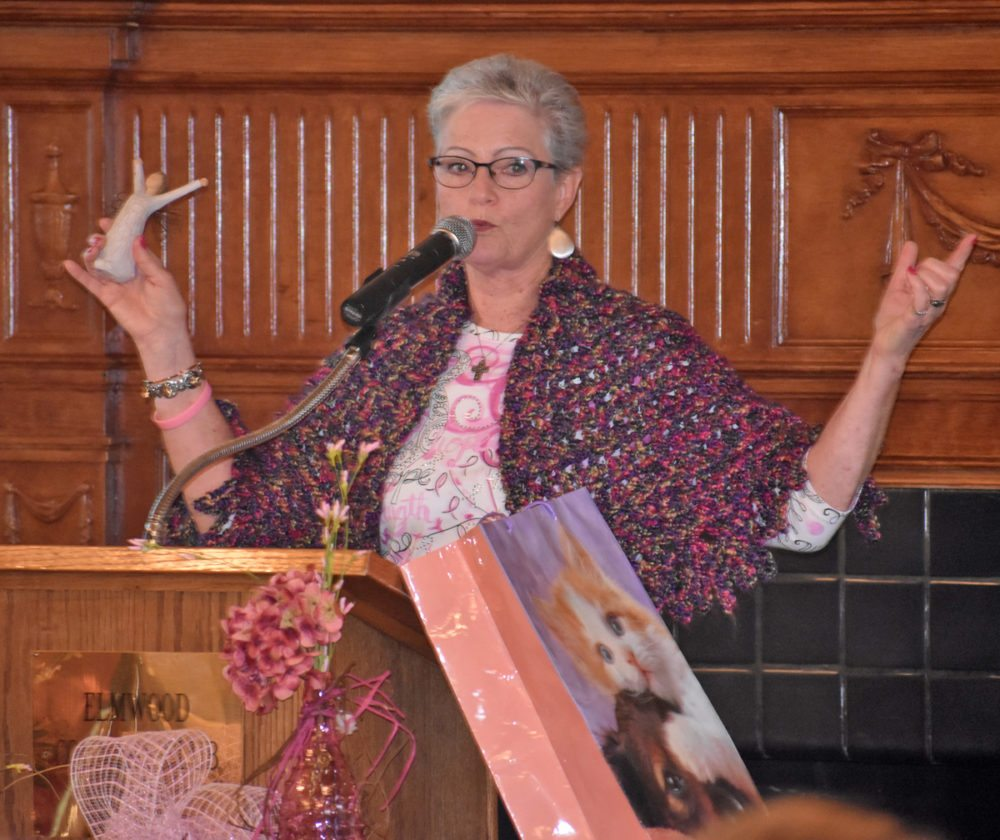 Cindy Soderberg of Marshalltown is wearing, displaying, and is surrounded by many gifts received from friends and family during her battle with cancer. Soderberg gave the keynote address at the UnityPoint Health-Marshalltown Foundation's Sixth Annual Breast Cancer Awareness Luncheon Thursday at Elmwood Country Club