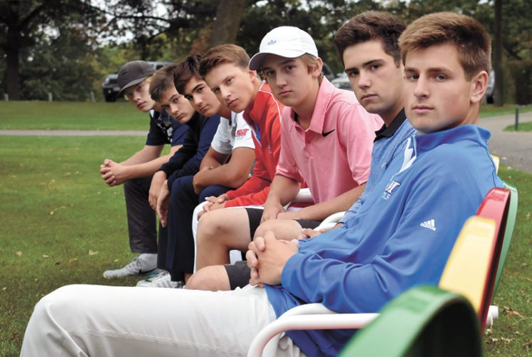 T-R PHOTO BY THORN COMPTON • The Marshalltown golf team sits in the chairs on the 18th green at Elmwood Country Club before the Bobcats' final practice on Thursday before the state tournament. Pictured are, from right, Luke Appel, JD Pollard, Cole Davis, Nate Vance, Keygan Hansen, Tate Carlson and Mason Reid.
