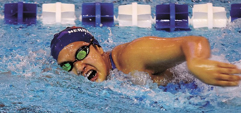 T-R PHOTO BY THORN COMPTON • Marshalltown junior Shakira Herrera competes in the 50-yard freestyle on Thursday in the Bobcats' home dual meet loss to Johnson.