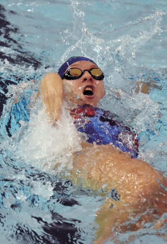 T-R PHOTO BY THORN COMPTON • Marshalltown junior Taylor Hrabak swims the backstroke leg of the 200-yard medley relay on Thursday in the Bobcats' home dual meet against Johnston. MHS lost the CIML Iowa Conference meet to the Dragons, 124-62.
