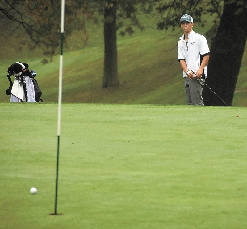 T-R PHOTO BY THORN COMPTON • Marshalltown senior Nate Vance rolls his chip shot within inches of the hole on the 18th green on Friday during the Iowa High School Boys State Golf Tournament at Elmwood Country Club. Vance currently sits in a tie for fourth place after his first-round score of 71.