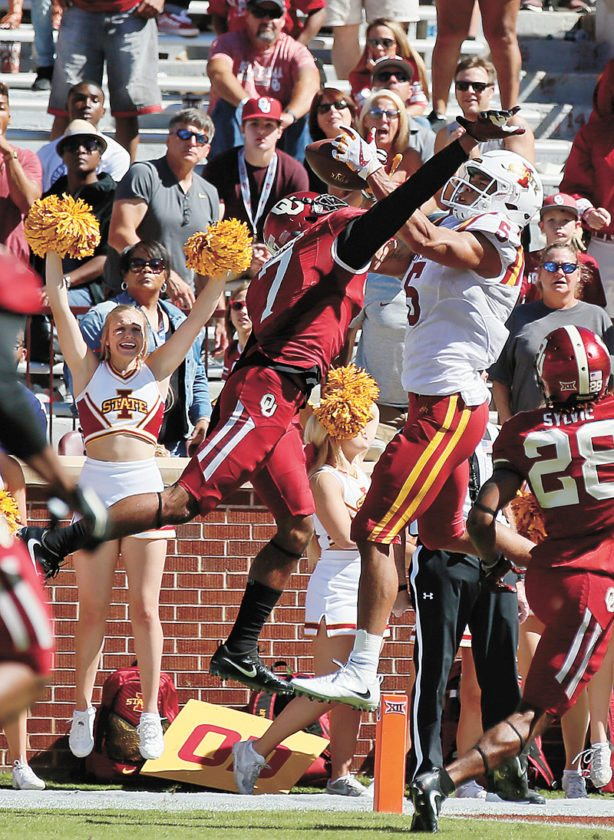 AP PHOTO • Iowa State wide receiver Allen Lazard (5) catches the game-winning touchdown between Oklahoma defensive backs Jordan Thomas (7) and Chanse Sylvie (28) in the fourth quarter of a Big 12 Conference football game Saturday in Norman, Okla. Iowa State won 38-31.