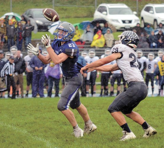 T-R PHOTO BY ROSS THEDE • Gladbrook-Reinbeck's Cael Wyatt (23) intercepts a pass intended for Hudson's Christian Seres (29) during the first quarter of Saturday's football game in Gladbrook.