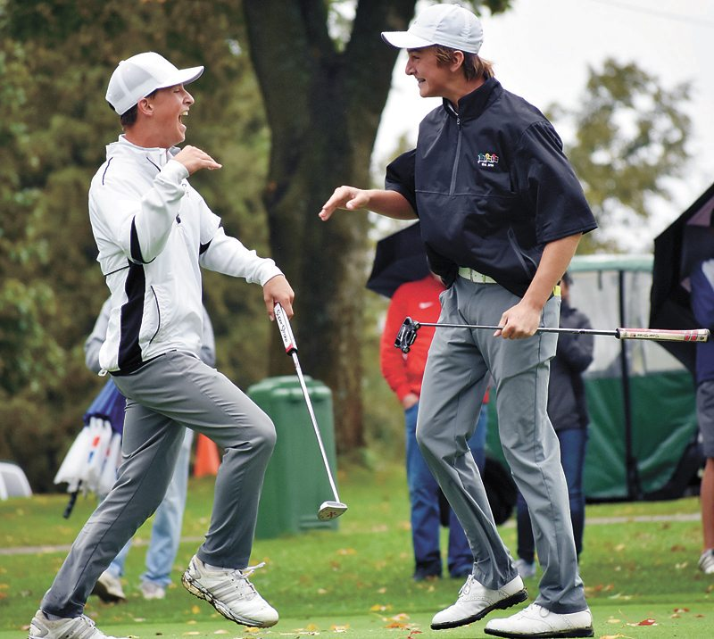 T-R PHOTO BY THORN COMPTON • Marshalltown sophomore Cole Davis, right, congratulates senior Nate Vance after Vance's eagle putt in the sudden-death playoff to win the individual state title on Saturday at Elmwood Country Club.