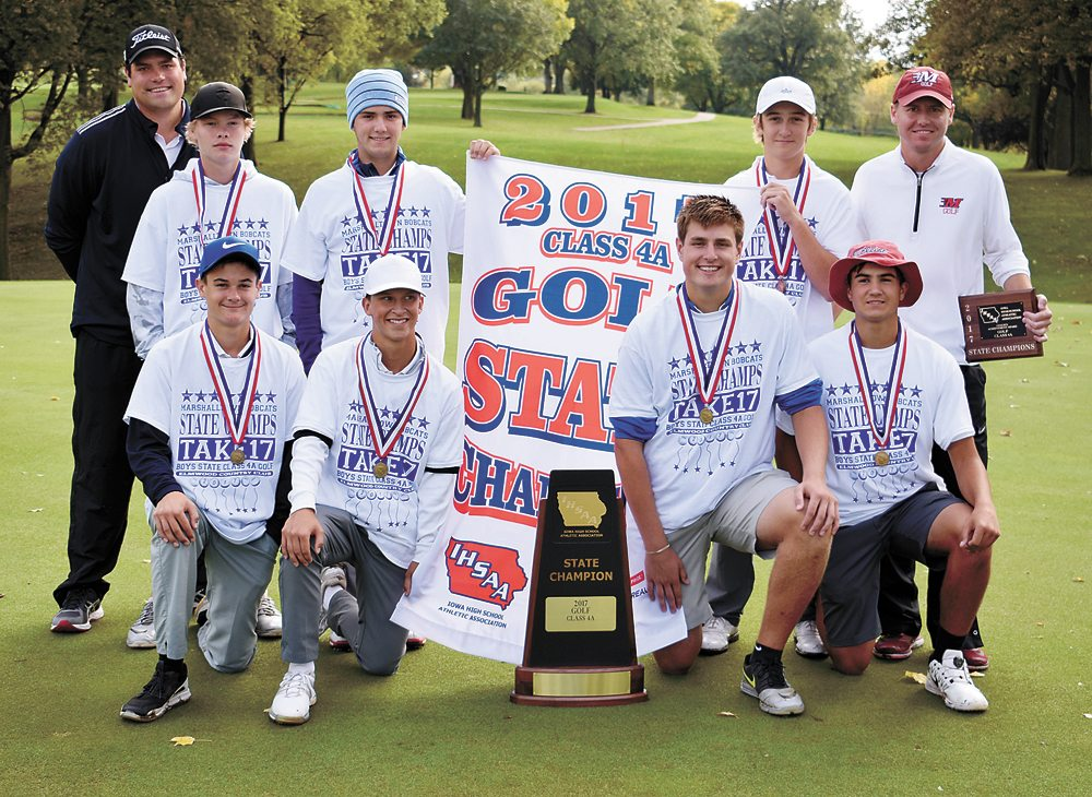 T-R PHOTO BY THORN COMPTON • The Marshalltown boys' golf team poses with its medals, banner and trophy after winning the 2017 state golf tournament on Saturday. Pictured are, front row: (from left) Tate Carlson, Nate Vance, Luke Appel, Keygan Hansen; back row: assistant coach Michael Appel, Mason Reid, JD Pollard, Cole Davis, head coach Lucas Johnson.