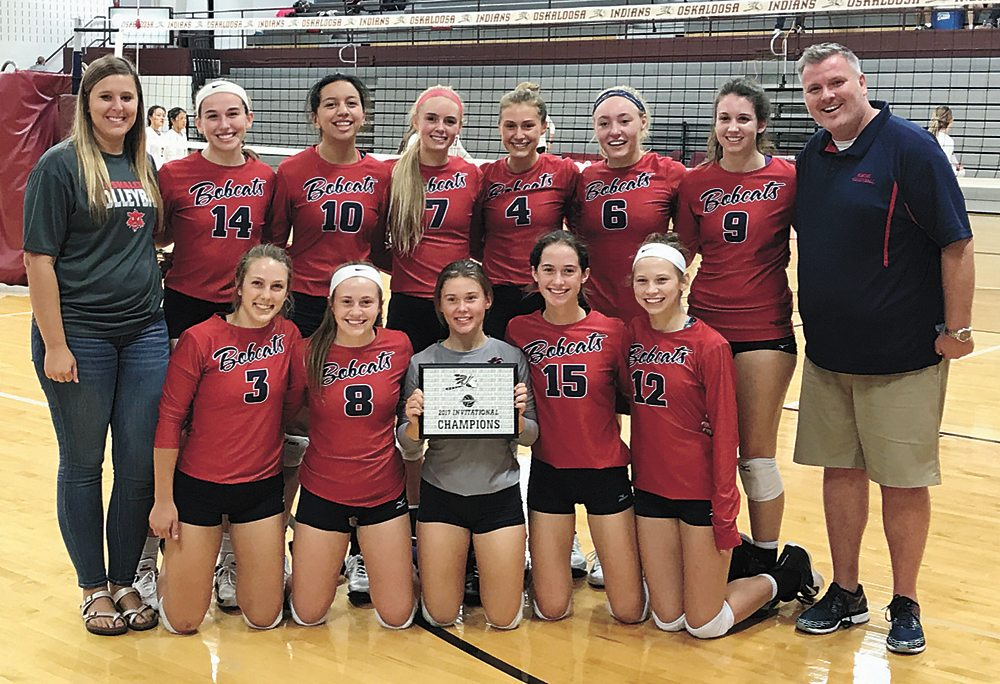 PHOTO PROVIDED • The Marshalltown volleyball team poses with its Oskaloosa Invitational championship plaque after winning Saturday's tournament.