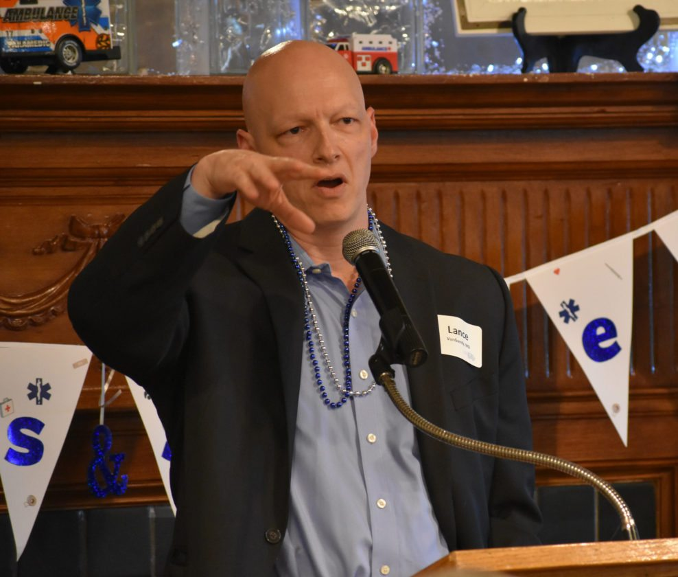 "T-R FILE PHOTO From this Aug. 17 photo, Dr. Lance VanGundy of Marshalltown gestures during the UnityPoint Health-Marshalltown Foundation ""Lights, Sirens, Keep Them Rolling"" fund-raising campaign kick-off event. VanGundy returned to UnityPoint Marshalltown's Emergency Department duties Oct. 1."