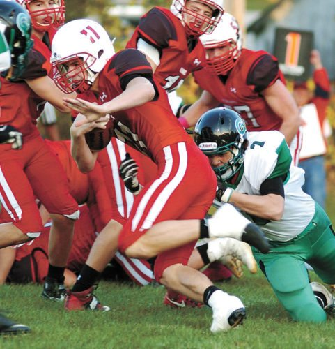 T-R PHOTO BY ROSS THEDE • North Tama's Tyler Morrison (11) runs out of the tackle attempt by Grand View Christian defender Colin Muir (7) during the first quarter of Monday's Class A District 5 football game in Traer. Morrison ran for three touchdowns in North Tama's 33-20 win.