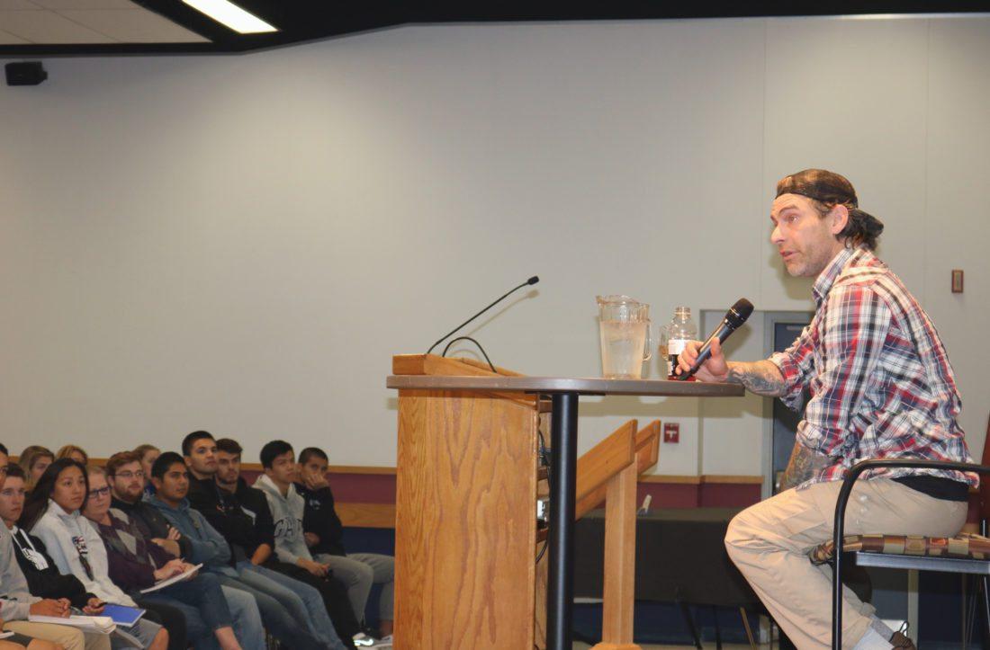 T-R PHOTO BY ADAM SODDERS Frank Meeink has gone from being a notorious neo-Nazi leader in the 1980s and 1990s to speaking out against hate and promoting empathy. He brought his message, and many gritty anecdotes, to Dejardin Hall at Marshalltown Community College Tuesday.