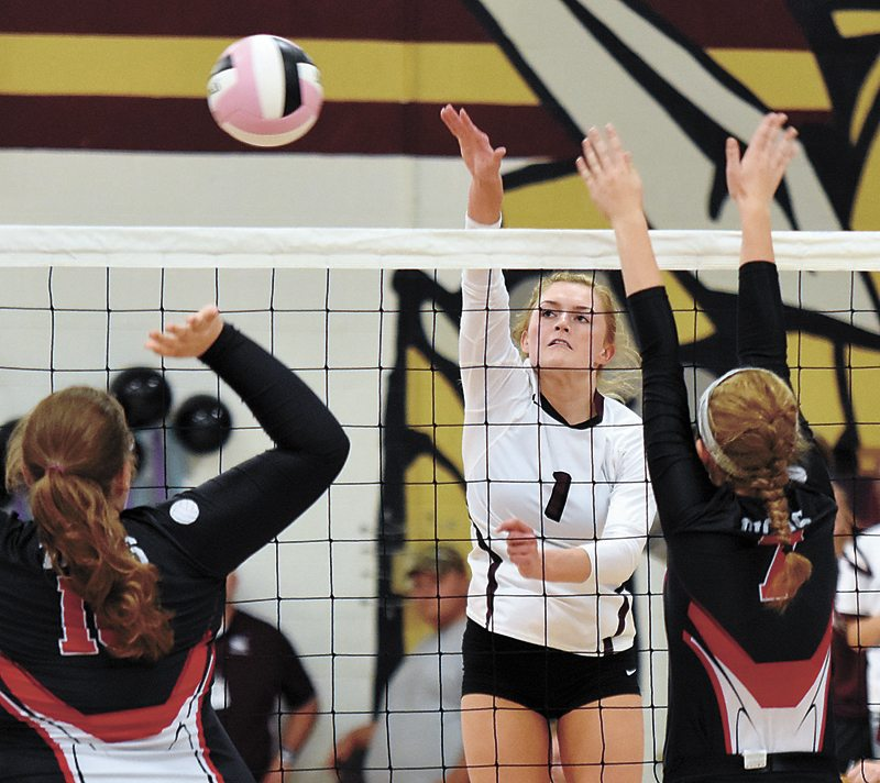 T-R PHOTO BY THORN COMPTON • Grundy Center senior Landry Luhring (1) sends a shot across the net towards South Hardin's Gillian Gear, left, and Holly Talbot during the Spartans' 3-0 sweep of the Tigers on senior night Tuesday.