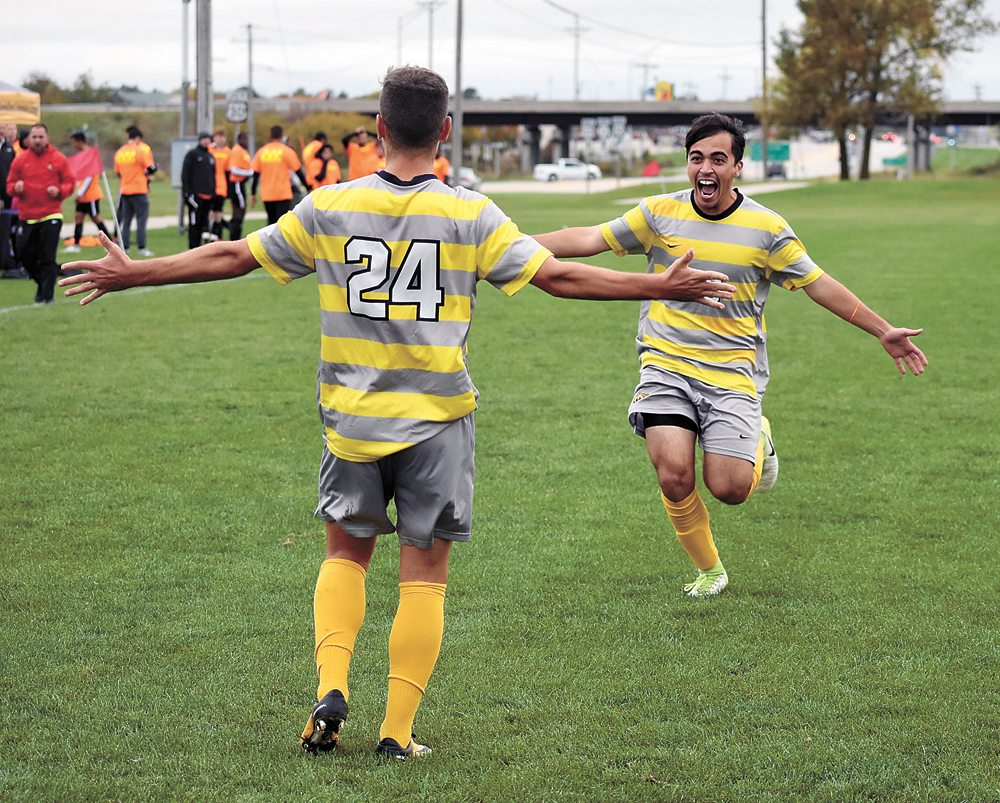 T-R PHOTO BY THORN COMPTON • Marshalltown Community College midfielder Rafael Vacas (24) waits with open arms as Evandro Resende rushes in to congratulate him after Vacas scored the game-tying goal against Indian Hills on Wednesday. The No. 14 Tigers went on to hand the No. 5 Warriors their first ICCAC loss of the season in a 2-1 decision.