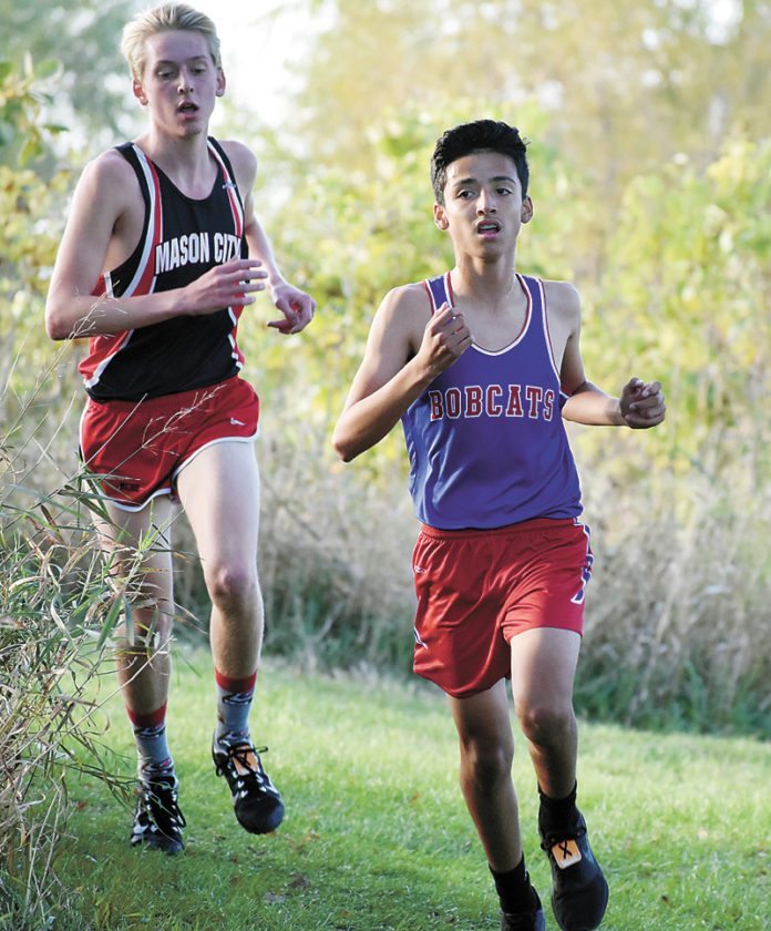 T-R PHOTO BY THORN COMPTON • Marshalltown freshman Javier Rodriguez heads through the intersection for the last time at the Marshalltown Community College course on Thursday during the CIML Iowa Confrence Meet. Rodriguez narrowly beat out senior Luke Pedersen for the top spot for the Bobcat boys.