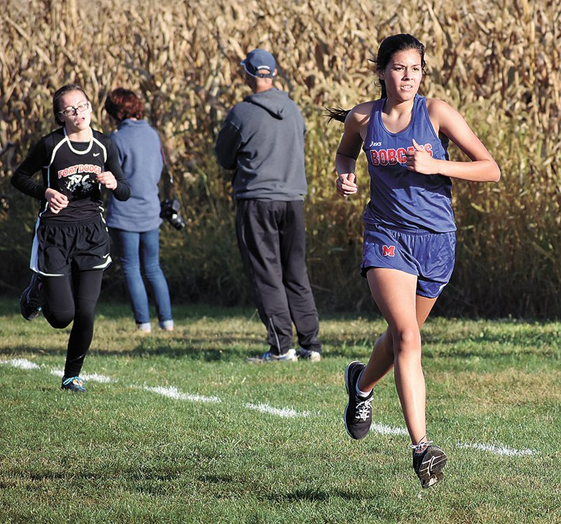 T-R PHOTO BY THORN COMPTON • Marshalltown sophomore Mia Barajas finishes out the final leg of the CIML Iowa Conference meet at the Marshalltown Community College course on Thursday.