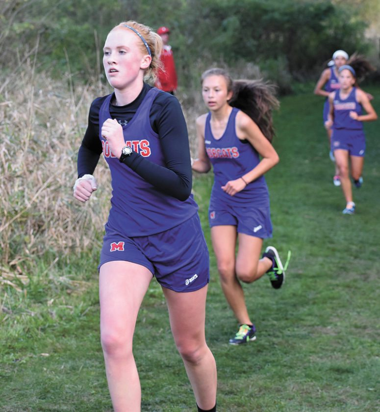T-R PHOTO BY THORN COMPTON • Marshalltown sophomore Kaci Uhde leads a pack of Bobcats on her way to finishing first for the MHS girls during the CIML Iowa Conference meet in Marshalltown on Thursday.