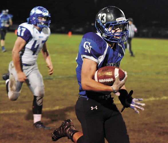 T-R PHOTO BY THORN COMPTON • Colo-NESCO running back Philip Bower races down the sideline on his way to scoring a 65-yard touchdown on Friday while Moravia junior Cole Ballenger gives chase during the Mohawks' 30-22 win over the Royals.