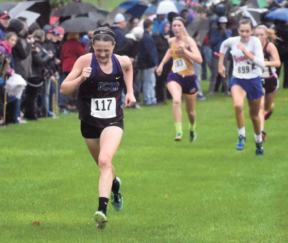T-R PHOTO BY THORN COMPTON • Grundy Center/Gladbrook-Reinbeck junior Lily Ehlers, left, approaches the finish line strong at the North Iowa Cedar League meet on Saturday while East Marshall's Melinda Puumala, center, gains on the girls in front of her. Ehlers would finish fourth in the meet, while Puumala came in fifth.