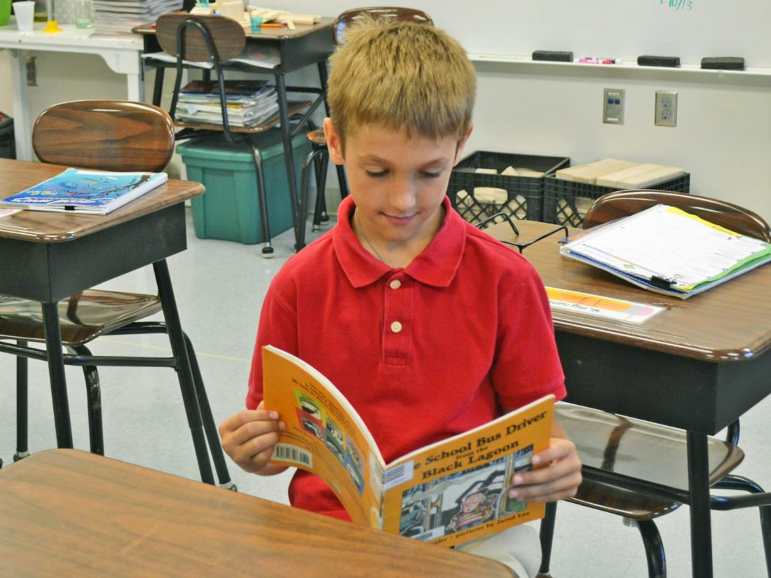 "T-R PHOTO BY SARA JORDAN-HEINTZ Jaxson Boswell, 8, a third grader at St. Francis Catholic School, enjoys keeping busy at school. He cited ""the teachers"" as the best part of the academic experience. He is known as a compassionate and hardworking pupil."