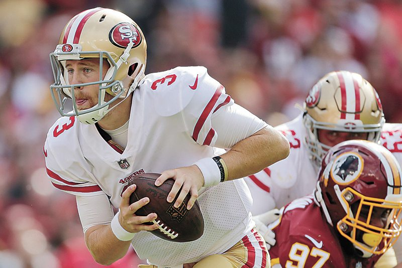 AP PHOTO • San Francisco 49ers quarterback C.J. Beathard (3) scrambles out of the pocket during the first half of an NFL game against the Washington Redskins on Sunday in Landover, Md.