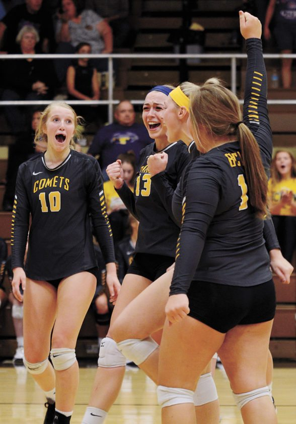 T-R PHOTO BY ROSS THEDE • BCLUW volleyball players, from left, Madison Ubben, Easton Swanson, Lauren Anderson and Cate Nason celebrate the final point of the Comets' Class 2A Region 5 victory over East Marshall on Tuesday night in Conrad.