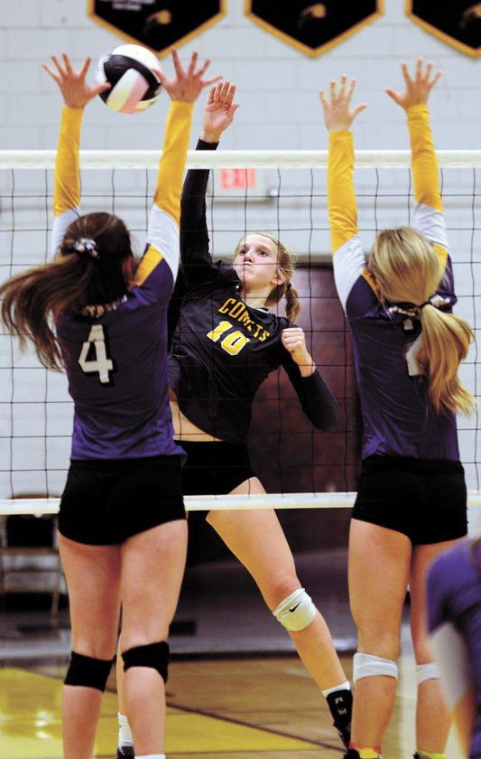 T-R PHOTO BY ROSS THEDE • BCLUW's Madison Ubben (10) tries to hit around the double block provided by East Marshall's Ryleigh Thompson (4) and McKaylie Coleman (2) during Tuesday's regional volleyball match.