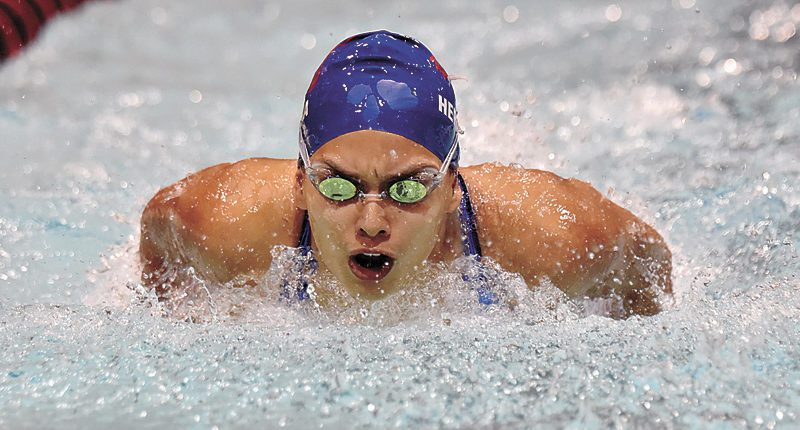 PHOTO BY BRITT KUDLA/THE FORT DODGE MESSENGER • Marshalltown junior Shakira Herrera competes in the 100-yard butterfly during Thursday's CIML Iowa Conference meet at Fort Dodge Senior High. Herrera placed fifth in the event in a time of 1 minute, 4.46 seconds.